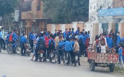 students standing outside the school