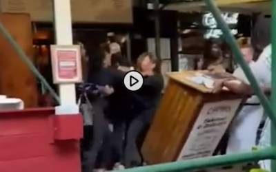 Carmine's restaurant at the Carmine's restaurant was punched and beaten by three Texan women after asking them for proof of vaccination