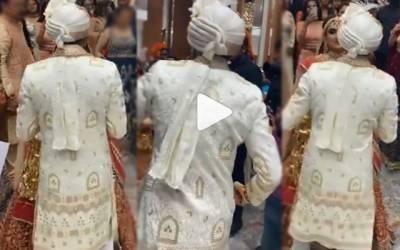 groom welcomes bride