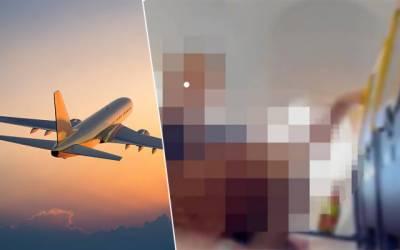 Couple caught on camera performing sex act on Ryanair flight
